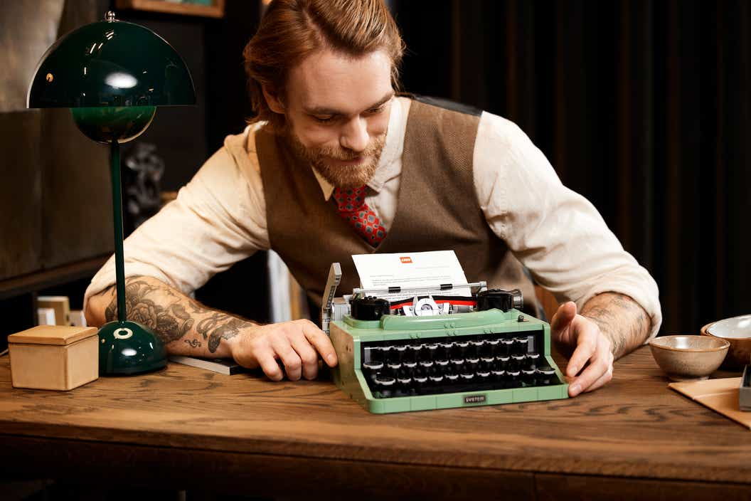 Lifestyle image of man and the LEGO Ideas Typewriter