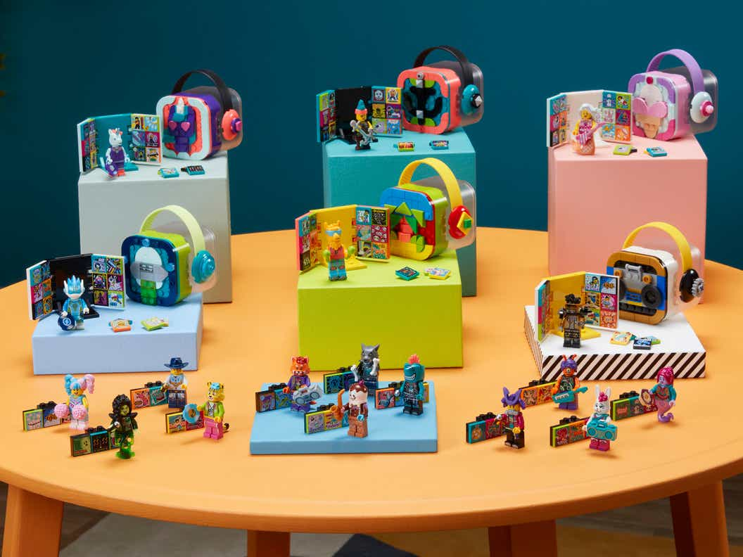 Image of all LEGO VIDIYO products arranged on a wooden table