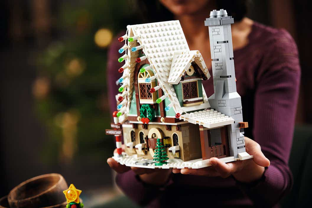 Image of a LEGO house with a Christmas tree in the background