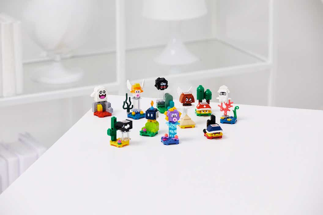 Small LEGO models of collectible enemy characters sitting on a white table