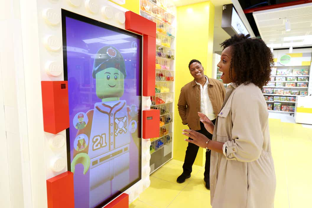 Lifestyle image of women trying the LEGO Expression screen