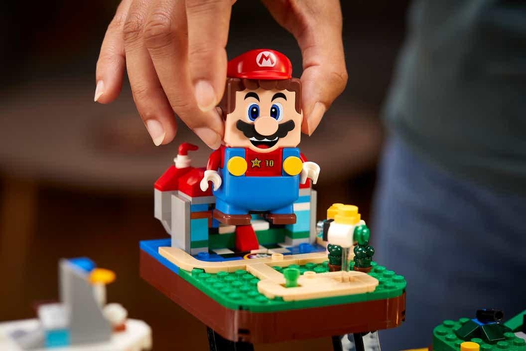 Lifestyle image of LEGO Super Mario jumping on the LEGO Super Mario 64 ? Block
