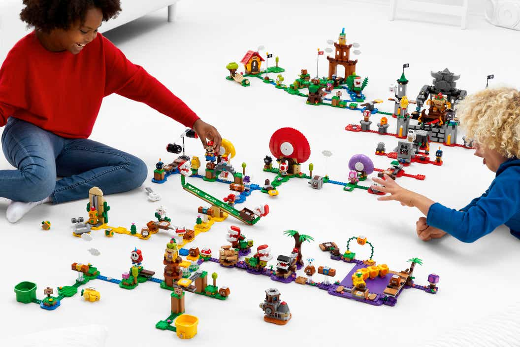 Image of children playing with a large LEGO Super Mario course