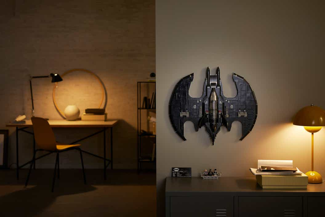 Image of a LEGO 1989 Batwing hanging on a wall in a living room
