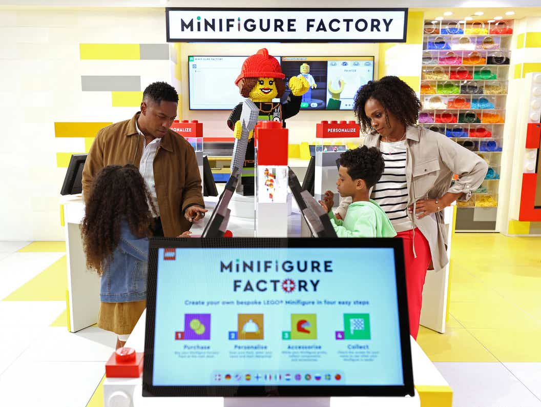 Lifestyle image of family trying out the Minifigure Factory