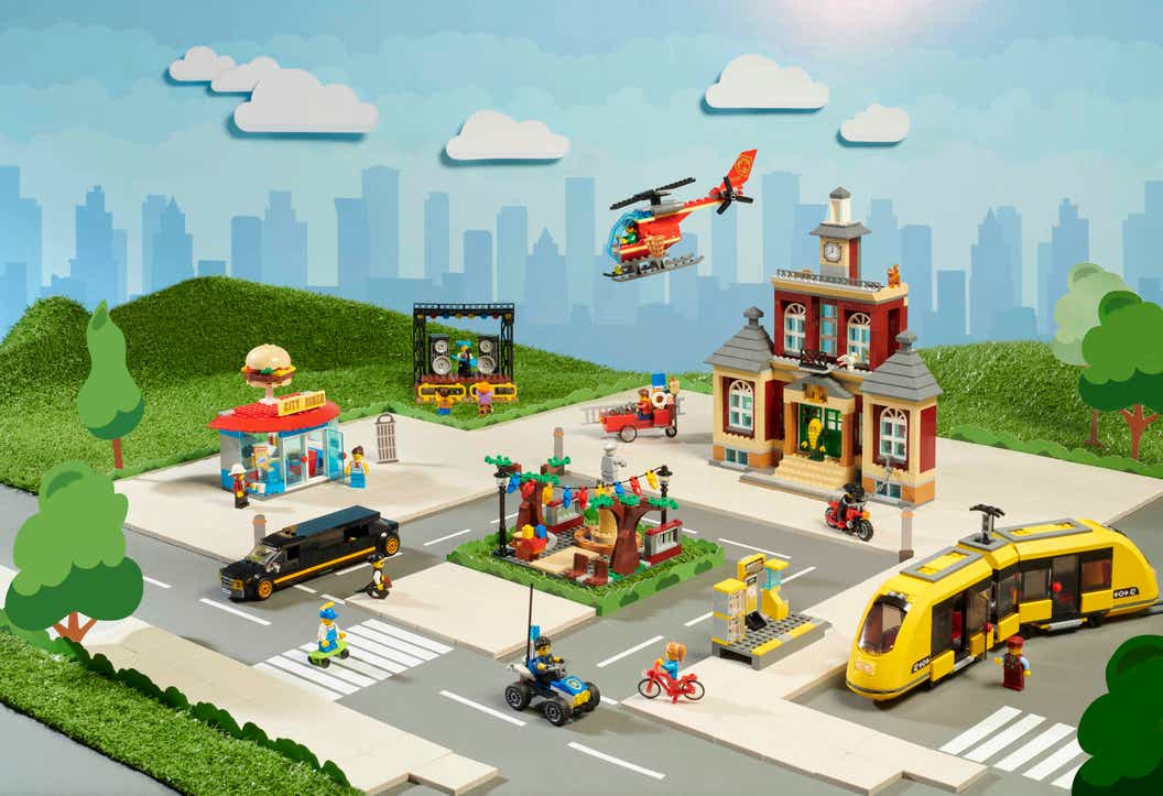 Image of full LEGO CITY Main Square set contents set on a backdrop