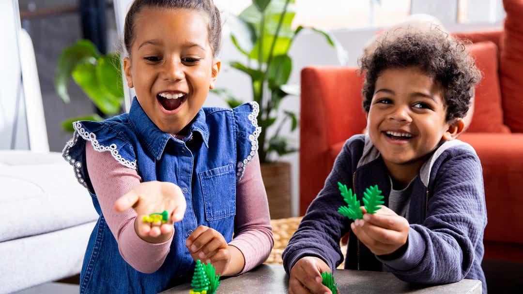 Image of children holding LEGO leaf elements