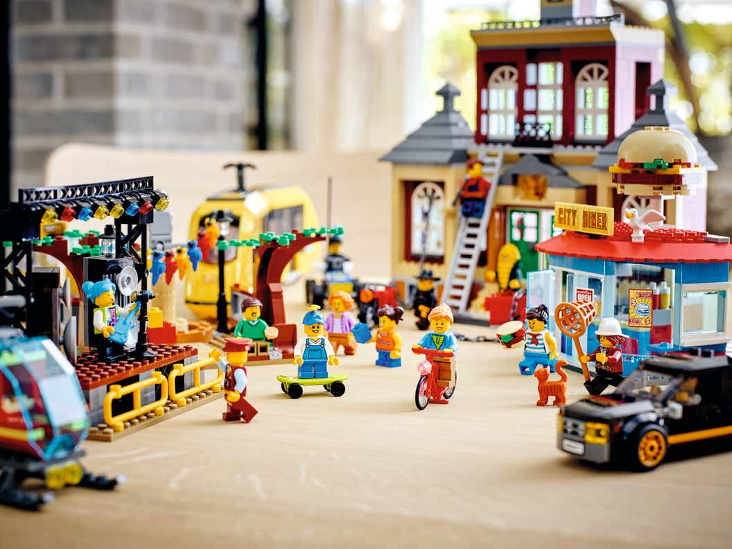 Image of minifigures in foreground with constructed buildings in background