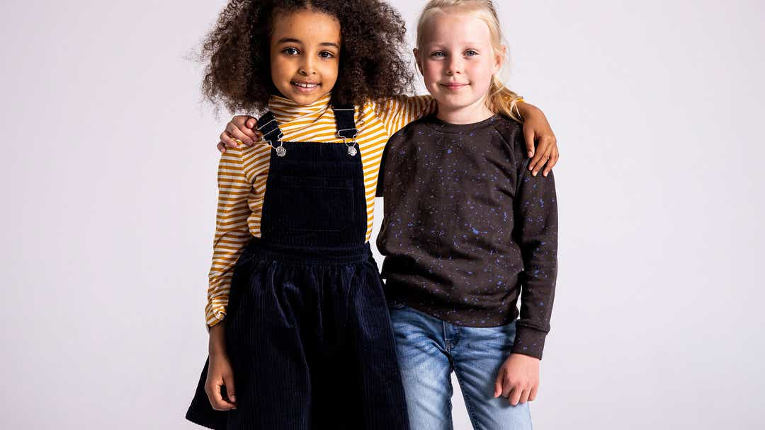 Image of two girls with their arms around one another
