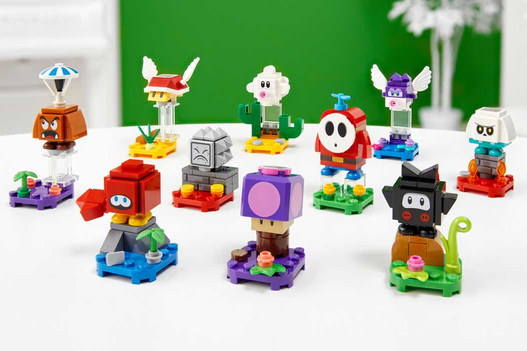 Image of ten characters displayed on a white table