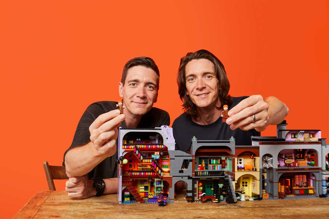 Oliver and James Phelps playing with the LEGO Diagon Alley set