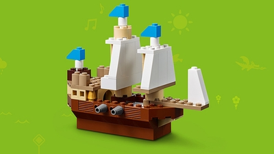 LEGO Classic Bricks Bricks Bricks - 10717 - Ahoy! Build a pirate ship with large white sails, canons and blue flags.