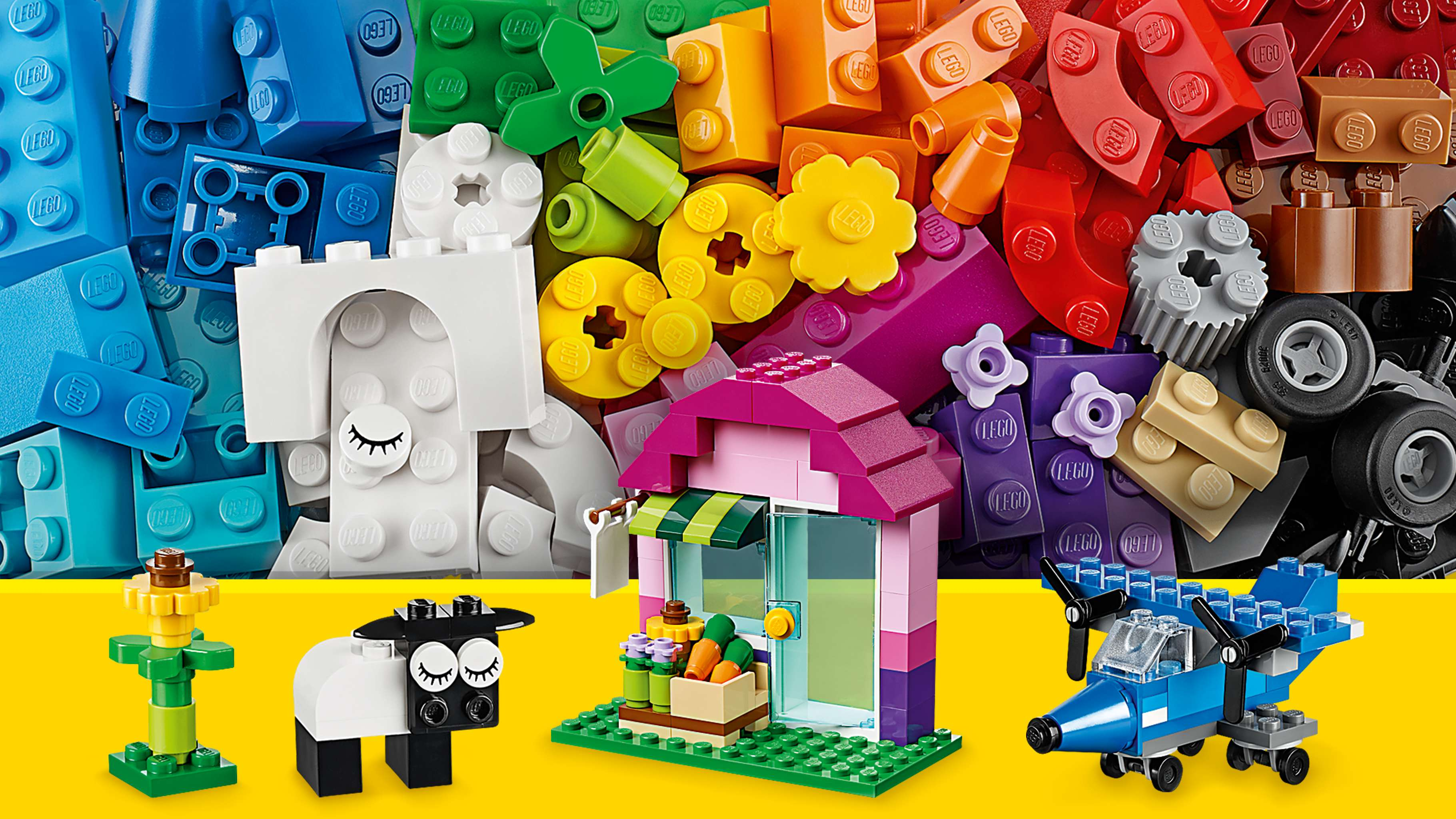 LEGO Classic Creative Bricks - 10692 - Use blue, green, pink, white and black bricks to build a sunflower, a house, a sheep or a plane with propellers.