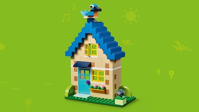 LEGO Classic Bricks Bricks Bricks - 10717 - Build a cosy house with a blue bird sitting on the roof.