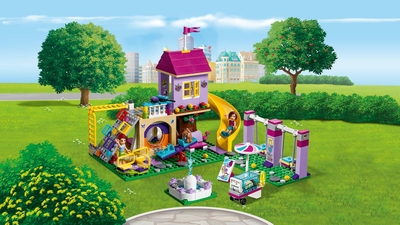 LEGO Friends - 41325 Heartlake City Playground - Sienna and Mia are on the playground with their puppy where they can take a ride on the slide, the swings, the seesaw, the carousel, the climbing wall, have fun and take a break with an ice cream.