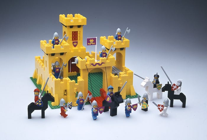 The very first Castle set. Fun fact: The horses in the original yellow Castle set were entirely brick-built. Today, they are molded figures.