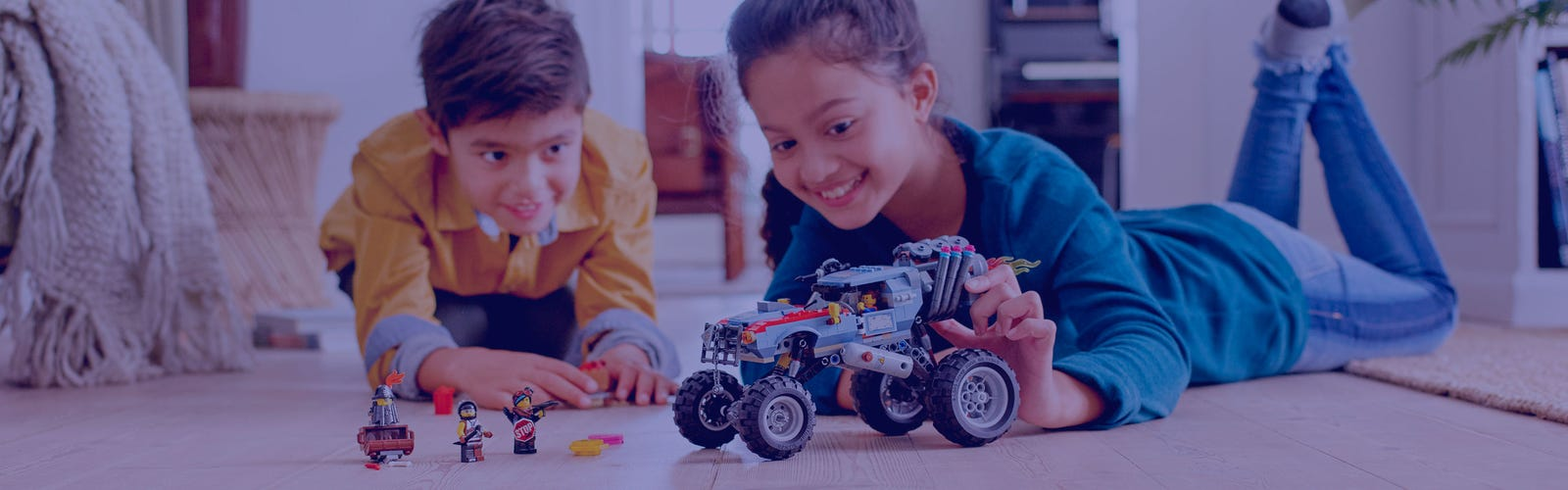 The LEGO Movie 2 Build More LIfestyle image boy and girl playing with combo product 70827+70829