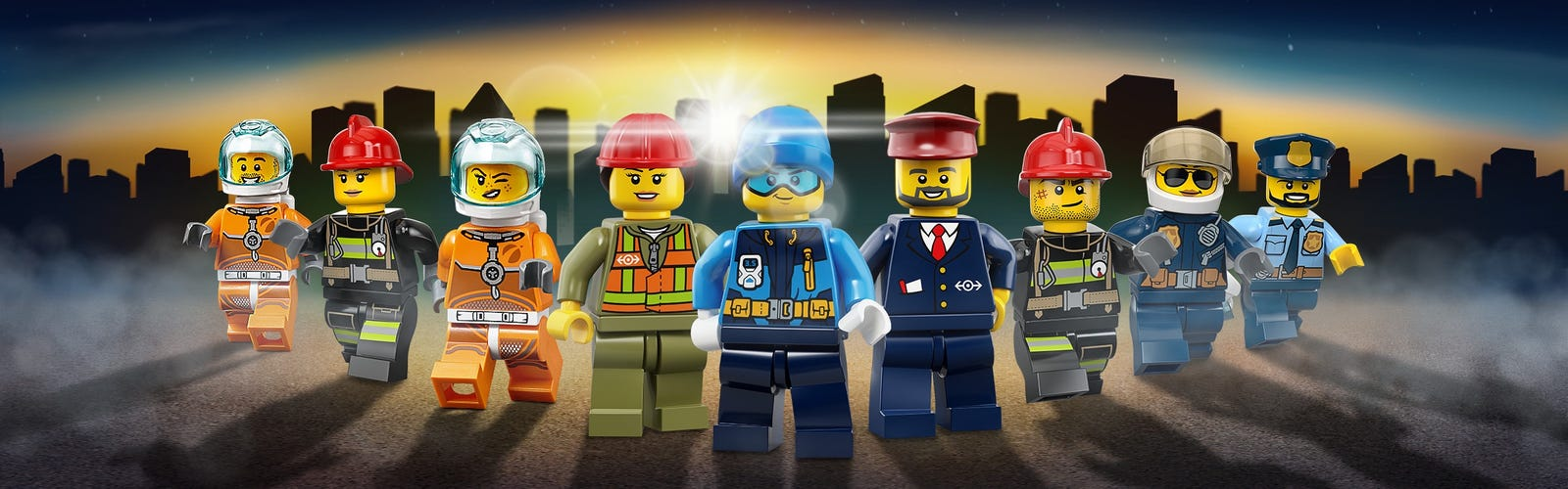 City minifgures posing in the sunset with a silhouette of LEGO® City background